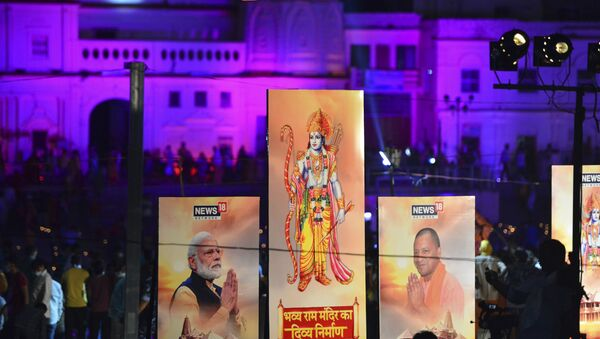 Banners with the images of (L-R) Indian Prime Minister Narendra Modi, Lord Ram and Chief Minister of Uttar Pradesh Yogi Adityanath are seen along the banks of the River Sarayu on the ever before the groundbreaking ceremony of the proposed Ram Temple in Ayodhya on August 4, 2020.  - Sputnik International