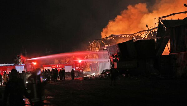 Firefighters douse a blaze at the scene of an explosion at the port of Lebanon's capital Beirut on August 4, 2020 - Sputnik International