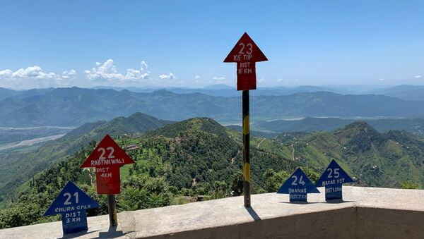 Signs displaying area distance are seen at a hilltop post during a trip organised by the army, near the Line of Control (LoC), in Charikot Sector, Kashmir July 22, 2020 - Sputnik International