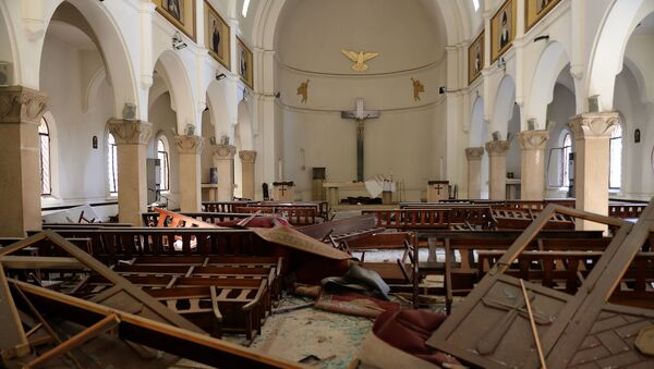The interior of a church is pictured in the aftermath of yesterday's blast that tore through Lebanon's capital and resulted from the ignition of a huge depot of ammonium nitrate at Beirut's port, on August 5, 2020 - Sputnik International