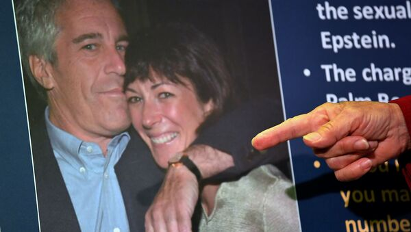 (FILES) In this file photo taken on July 2, 2020 a photo of Ghislaine Maxwell and Jeffrey Epstein is seen as acting US Attorney for the Southern District of New York, Audrey Strauss, announces charges against Maxwell during a press conference in New York City - Sputnik International