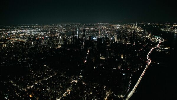 A large section of Manhattan's Upper West Side and Midtown neighborhoods are seen in darkness from above during a major power outage on July 13, 2019 in New York City.  - Sputnik International