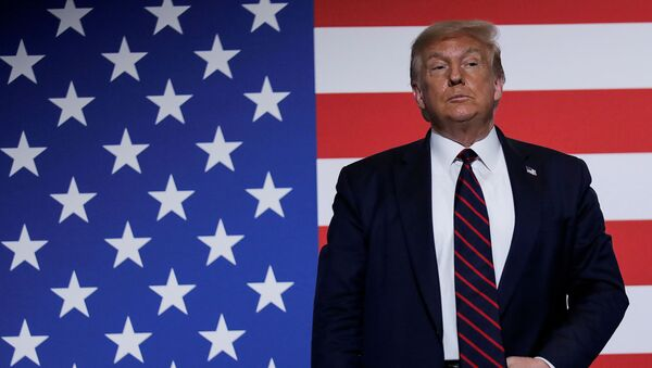 U.S. President Donald Trump stands in front of a U.S. flag as he participates in a roundtable on donating plasma during a visit to the American Red Cross National Headquarters in Washington, U.S., July 30, 2020 - Sputnik International