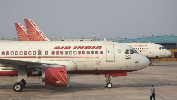 In this photograph taken on March 2, 2020, an Air India plane is parked at Indira Gandhi International airport in New Delhi. - Sputnik International