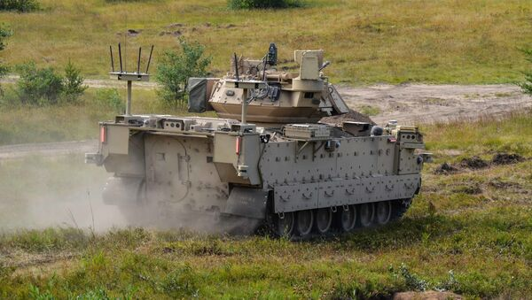 Modified Bradley Fighting Vehicles known as Mission Enabling Technologies Demonstrators (MET-D) and modified M113 tracked armored personnel carriers, known as Robotic Combat Vehicles (RCVs) are being utilized in a soldier operation experimentation at Ft. Carson, Col., from June 15 – Aug. 14, 2020. - Sputnik International