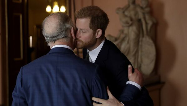 Britain's Prince Harry kisses and greets his father Prince Charles upon their separate arrival to attend a coral reef health and resilience meeting with speeches and a reception with delegates at Fishmongers Hall in London, 14 February 2018 - Sputnik International