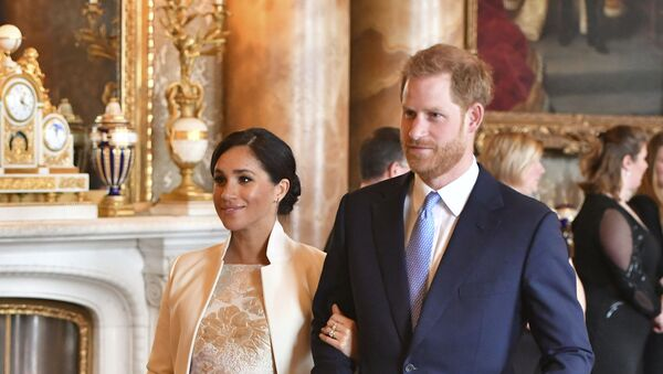 Britain's Prince Harry and Meghan, Duchess of Sussex attend a reception at Buckingham Palace, London, Tuesday March 5, 2019, to mark the fiftieth anniversary of the investiture of the Prince of Wales - Sputnik International