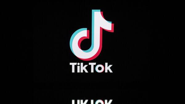 This file photo taken on November 21, 2019, shows the logo of the social media video sharing app Tiktok displayed on a tablet screen in Paris. - Sputnik International