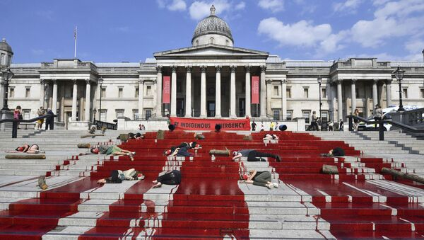 Red dye covers the steps outside the National Gallery of art as Extinction Rebellion protesters symbolically play dead, in a solidarity action for indigenous communities in Brazil - Sputnik International