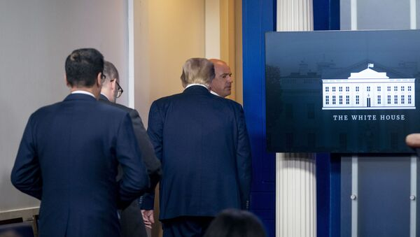 President Donald Trump is asked to leave the James Brady Press Briefing Room by a member of the U.S. Secret Service during a news conference at the White House, Monday, Aug. 10, 2020. - Sputnik International