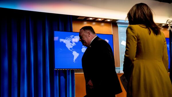 U.S. Secretary of State Mike Pompeo, accompanied by State Department spokeswoman Morgan Ortagus, leaves a news conference at the State Department in Washington, D.C., U.S.,  July 15, 2020. - Sputnik International