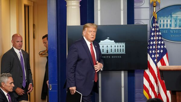 U.S. President Donald Trump arrives during the beginning of a coronavirus disease (COVID-19) pandemic briefing at the White House in Washington, U.S., August 10, 2020 - Sputnik International