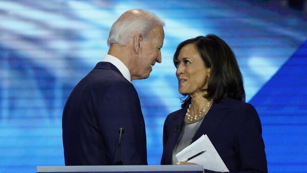 Democratic presidential candidate former Vice President Joe Biden, left, and then-candidate Sen. Kamala Harris, D-Calif. shake hands after a Democratic presidential primary debate hosted by ABC at Texas Southern University in Houston. Biden has chosen Harris as his running mate - Sputnik International