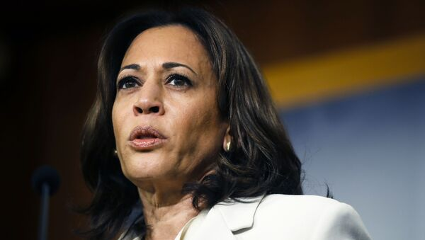 Sen. Kamala Harris, D-Calif., talks to reporters about the impeachment trial of President Donald Trump on charges of abuse of power and obstruction of Congress, at the Capitol in Washington, Thursday, Jan. 16, 2020 - Sputnik International