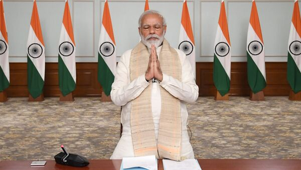 In this photo released by India Government Press Information Bureau, Indian Prime Minister Narendra Modi pays tributes to  Indian soldiers killed during confrontation with Chinese soldiers in the Ladakh region as he holds a video conference with chief ministers, in New Delhi, India, June 17, 2020 - Sputnik International