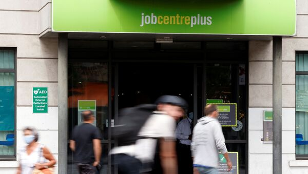 People walk past a branch of Jobcentre Plus, a government run employment support and benefits agency, as the outbreak of the coronavirus disease (COVID-19) continues, in Hackney, London, Britain, August 6, 2020 - Sputnik International