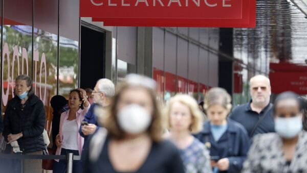 People, some wearing masks queue outside a John Lewis store, in London, Thursday, July 16, 2020. Unemployment across the U.K. has held steady during the coronavirus lockdown as a result of a government salary support scheme, but there are clear signals emerging that job losses will skyrocket over coming months - Sputnik International
