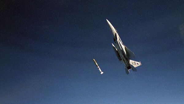 An air-to-air left side view of an F-15 Eagle aircraft releasing an anti-satellite (ASAT) missile during a test on Sep. 13, 1985, at the Pacific Missile Test Range, CA - Sputnik International