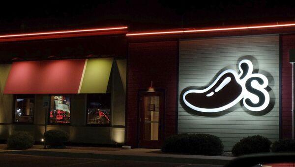 A Chili's restaurant logo stands lit in El Paso, Tex., Wednesday, Oct. 23, 2019.  - Sputnik International