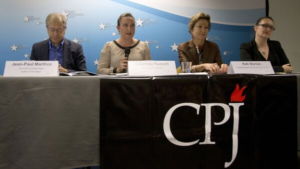 From left, EU correspondent for the Committee to Protect Journalists, Jean-Paul Marthoz, Advocacy Director for the CPJ, Courtney Radsch, Board member and former chairperson for the CPJ, Kati Marton and Central Asia Program Coordinator for the CPJ, Nina Ognianova address a media conference  in Brussels on Tuesday, Sept. 29, 2015. - Sputnik International