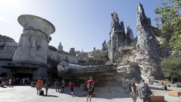 Park visitors walk near the entrance to the Millennium Falcon Smugglers Run ride during a preview of the Star Wars themed land, Galaxy's Edge in Hollywood Studios at Disney World, Tuesday, Aug. 27, 2019, in Lake Buena Vista, Fla. - Sputnik International