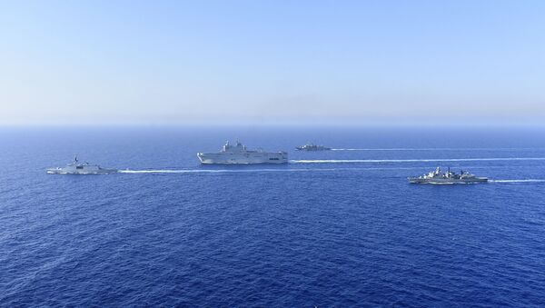 In this photo provided by the Greek National Defence, a French Tonnerre helicopter carrier, center, and French Lafayette frigate, left, are escorted by Greek and French military vessels during a maritime exercise in the Eastern Mediterranean, Thursday, Aug. 13, 2020 - Sputnik International