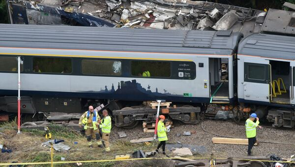 Emergency services inspect the site, following the derailment of the ScotRail train which cost the lives of three people, near Stonehaven, Aberdeenshire, Scotland, Britain August 13, 2020. - Sputnik International