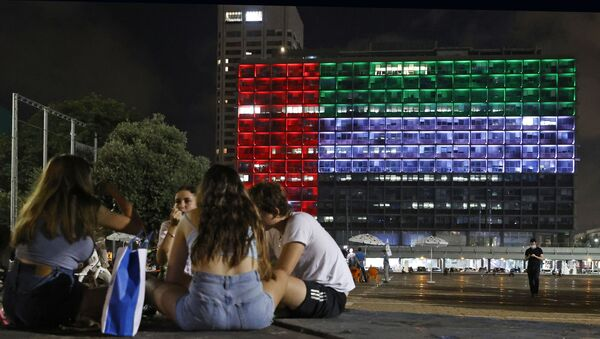 The city hall in the Israeli coastal city of Tel Aviv is lit up in the colours of the United Arab Emirates national flag on August 13, 2020. - Israel and the UAE agreed to normalise relations in a landmark US-brokered deal, only the third such accord the Jewish state has struck with an Arab nation. The agreement, first announced by US President Donald Trump on Twitter, will see Israel halt its plan to annex large parts of the occupied West Bank, according to the UAE. - Sputnik International