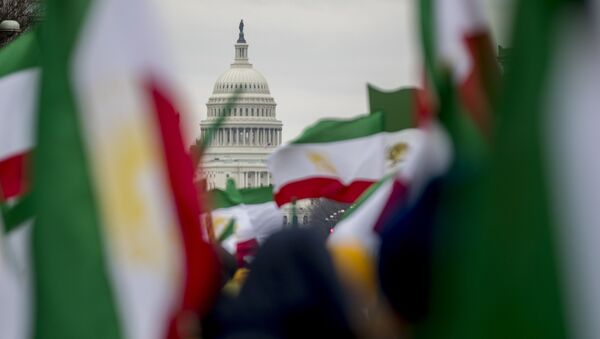 The Dome of the U.S. Capitol building is visible through Iranian flags during an Organization of Iranian-American Communities rally at Freedom Plaza in Washington, Friday, March 8, 2019 - Sputnik International