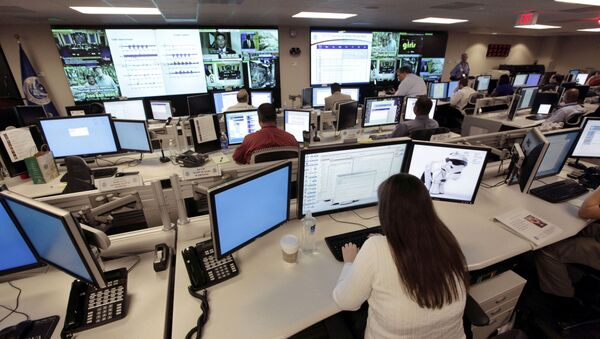 In this Sept. 24, 2010, file photo the National Cybersecurity & Communications Integration Center (NCCIC) prepares for the Cyber Storm III exercise at its operations center in Arlington, Va. - Sputnik International