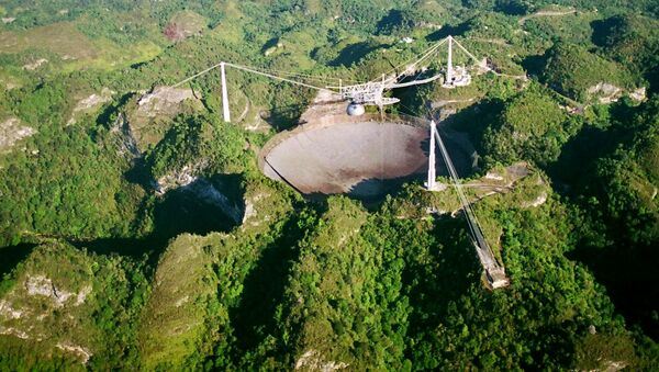 The world's largest radio telescope is seen from the air in this Wednesday, March 26, 2003 photo at the Arecibo Observatory, Puerto Rico - Sputnik International