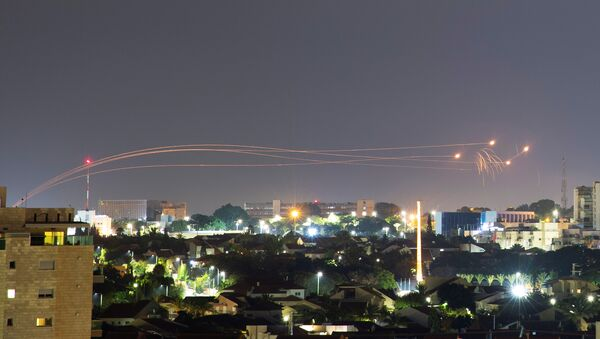 Iron Dome anti-missile system fires interception missiles as rockets are launched from Gaza towards Israel, as seen from the city of Ashkelon, Israel, August 16, 2020 - Sputnik International