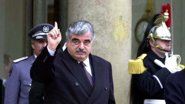 Lebanese Prime Minister Rafik Hariri leaves the Elysee Palace following a meeting with French President Jacques Chirac in Paris, France, February 27, 2001 - Sputnik International