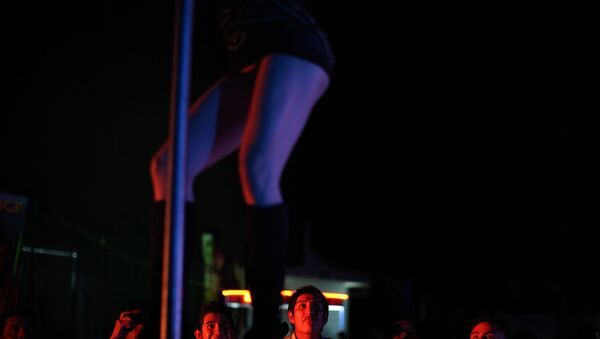 In this photo taken on Friday, March 2, 2012, an exotic dancer performs during the 2012 Sex and Entertainment Expo in Mexico City.  The Sex and Entertainment Expo is an annual event where vendors in the sex industry promote their goods and local strip clubs offer a glimpse of their establishments. - Sputnik International