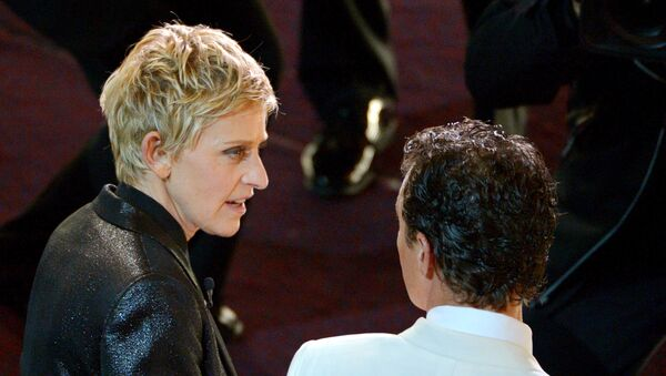 Ellen DeGeneres, left, and Matthew McConaughey are seen in the audience during the Oscars at the Dolby Theatre on Sunday, March 2, 2014, in Los Angeles - Sputnik International