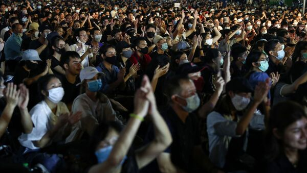 Pro-democracy protesters attend a rally to demand the government to resign, to dissolve the parliament and to hold new elections under a revised constitution, near the Democracy Monument in Bangkok, Thailand, August 16, 2020. - Sputnik International