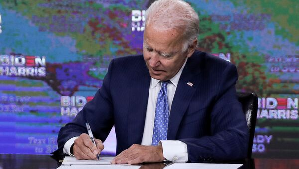 Democratic presidential candidate Joe Biden signs official documents needed to receive his party's official nomination next week during an event in Wilmington, Delaware, U.S., August 14, 2020. - Sputnik International