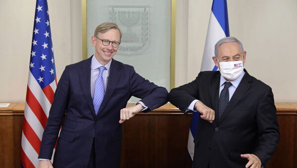 Israeli Prime Minister Benjamin Netanyahu, right, and US special envoy for Iran, Brian Hook, touch elbows to help prevent the spread of the coronavirus, at the Prime Minister's office in Jerusalem, Tuesday June 30, 2020 - Sputnik International