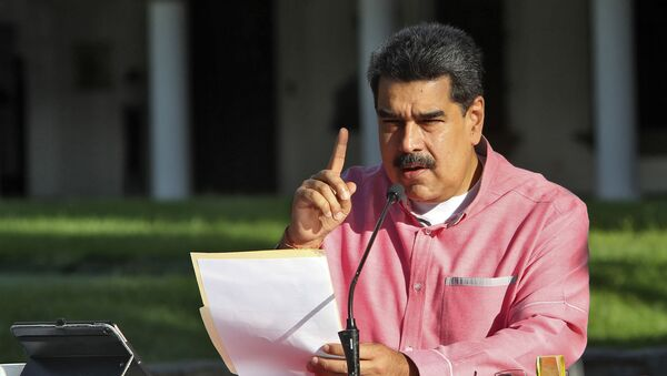 Handout picture released by the Venezuelan Presidency showing Venezuela's President Nicolas Maduro announcing in a televised message to the nation the extension, for the fifth time, of the state of alarm due to the COVID-19 novel coronavirus pandemic, in Caracas on August 9, 2020 - Sputnik International