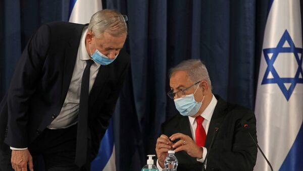 FILE PHOTO: Israeli Prime Minister Benjamin Netanyahu speaks with Alternate Prime Minister and Defence Minister Benny Gantz, as they both wear a protective mask due to the ongoing coronavirus disease (COVID-19) pandemic, during the weekly cabinet meeting in Jerusalem June 7, 2020 - Sputnik International
