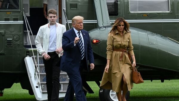 U.S. President Donald Trump, First Lady Melania Trump and their son Barron disembark from Marine One upon returning to the White in Washington, U.S. August 16, 2020. - Sputnik International
