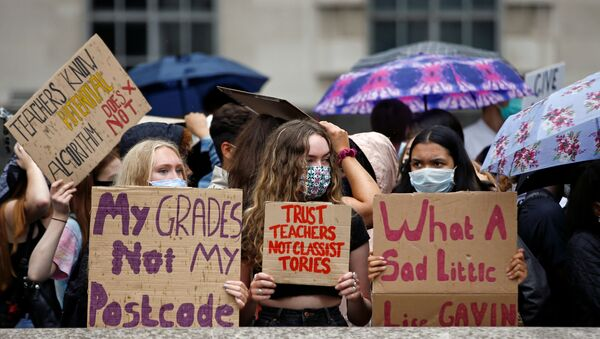 FILE PHOTO: A-level students hold placards as they protest opposite Downing Street, amid the ongoing coronavirus (COVID-19) pandemic, in London, Britain, 16 August 2020.  - Sputnik International