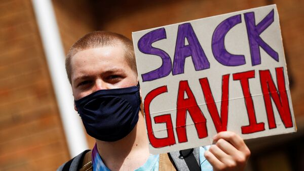 A-level student holds a placard during a protest about the exam results at the constituency offices of Education Secretary Gavin Williamson, amid the spread of the coronavirus disease (COVID-19), in South Staffordshire, Britain, August 17, 2020 - Sputnik International
