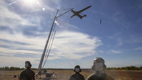 U.S. Marines with Air Combat Element, Marine Rotational Force – Darwin recover the RQ-21A Blackjack following spoke operations in Bradshaw Field Training Area, Northern Territory, Australia, Aug. 9, 2020 - Sputnik International