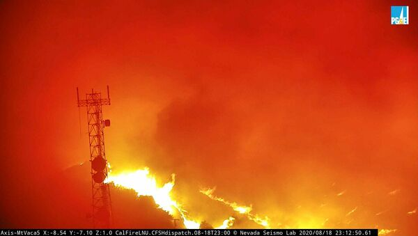 Flames from the Hennessey Fire rage in the last image from a tower-mounted camera before it and another went offline, after they melted in the heat according to AlertWildfire, on Atlas Peak northwest of Vacaville, California, U.S. August 18, 2020. Picture taken August 18, 2020.   www.alertwildfire.org/Handout via REUTERS.  NO RESALES. NO ARCHIVES. THIS IMAGE HAS BEEN SUPPLIED BY A THIRD PARTY. - Sputnik International