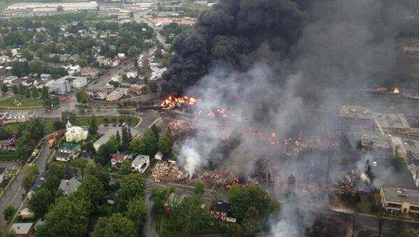 The crude-by-rail explosion in Lac-Mégantic, Canada, killed 47 people in 2013. - Sputnik International