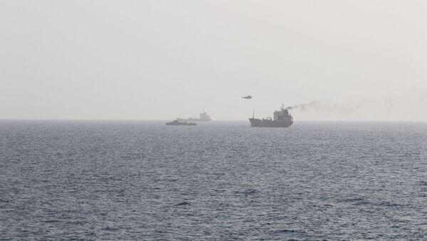 This picture released by the U.S. Navy allegedly shows members of the Iranian forces fast-roping onto civilian tanker WILA en-route to the UAE from a Sea King helicopter, in international waters in the Strait of Hormuz, August 12, 2020 - Sputnik International