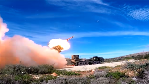 An MIM-104 Patriot surface-to-air missile is fired during a test on Crete - Sputnik International