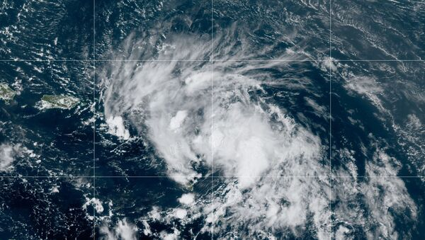 Satellite image released by the National Oceanic and Atmospheric Administration (NOAA) shows Tropical Storm Laura in the North Atlantic Ocean, Friday, Aug. 21, 2020.  - Sputnik International