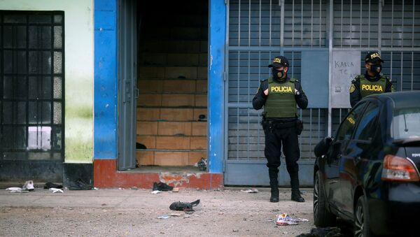 Police officers stand guard outside a nightclub after it was raided for hosting a party in violation of the coronavirus disease (COVID-19) restrictions, in Lima, Peru, August 23, 2020. - Sputnik International
